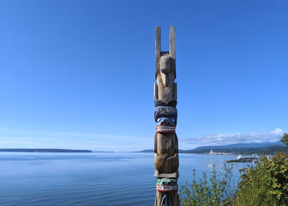Totem pole in front ocean view near Powell River