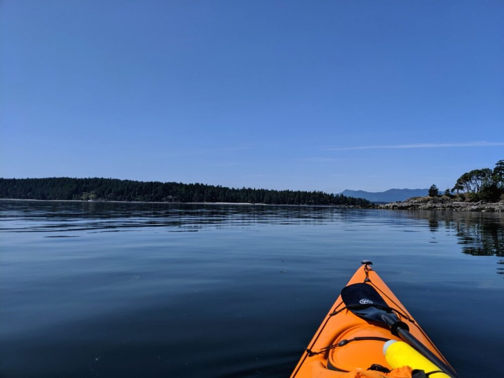 Point of view kayak paddling shot looking towards Salt Spring Island