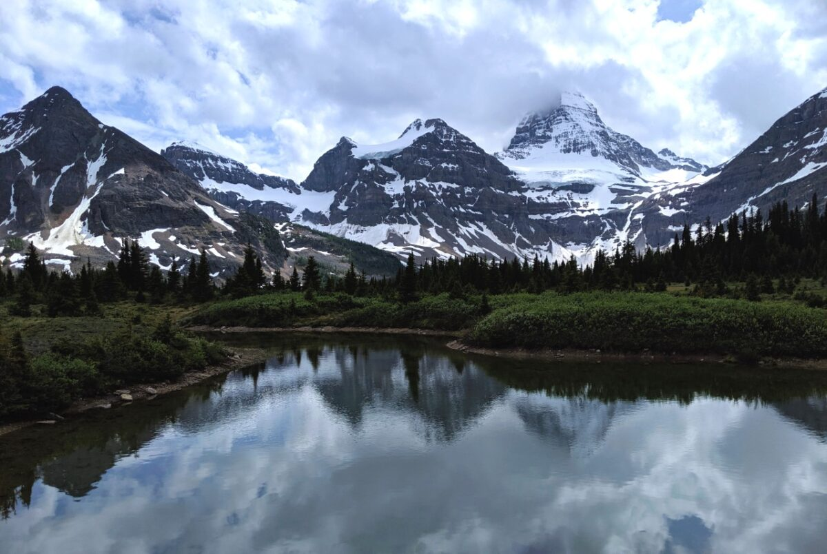 Mountain reflections on alpine lake in Mount Assiniboine Provincial Park
