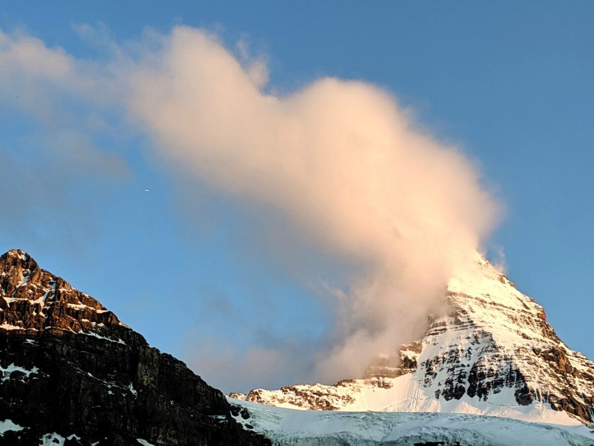 The summit of Mount Assiniboine with cloud over summit