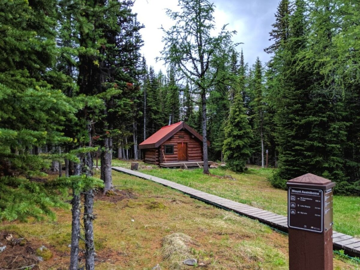 Wooden cabin with signpost in Mount Assiniboine Provincial Park