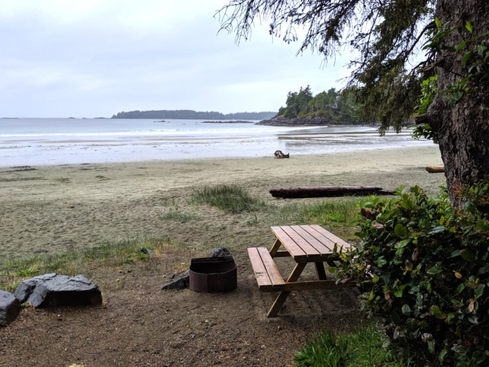 Picnic table and fire pit from campsite just behind Mackenzie beach with panoramic views of the ocena