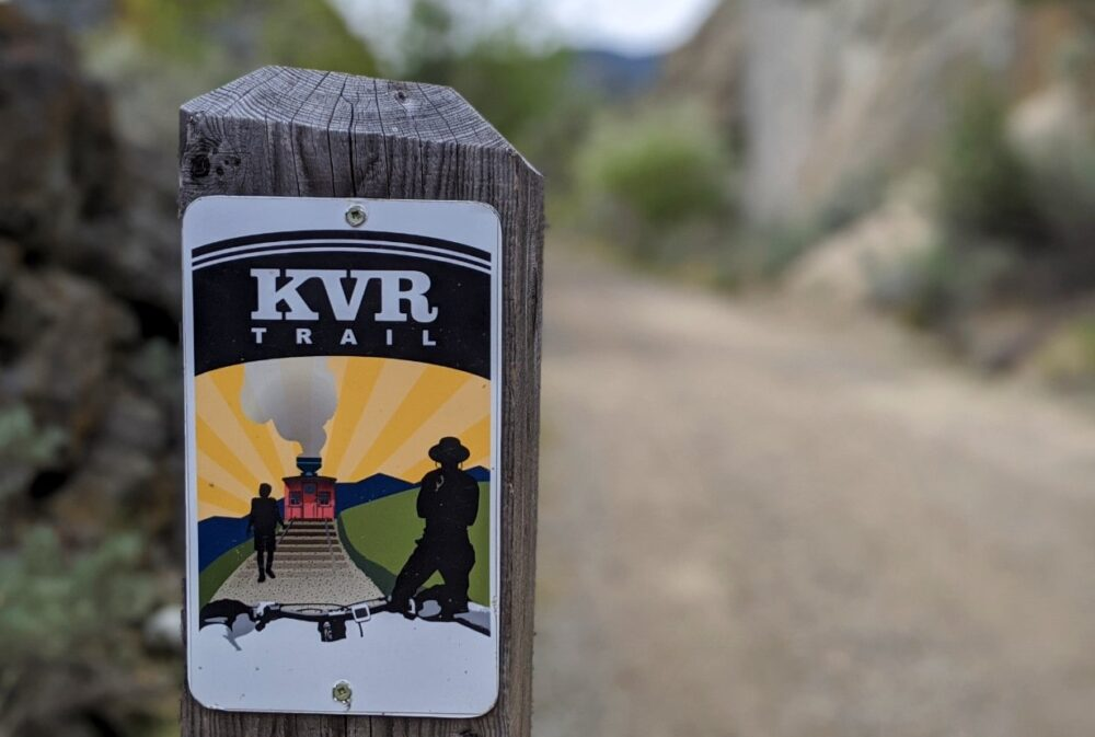 KVR trail on wooden post with view of trail behind