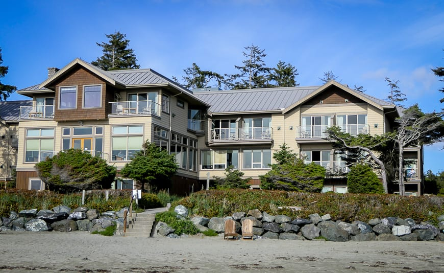 Two story Long Beach Lodge building with large windows, located just behind Cox Bay beach
