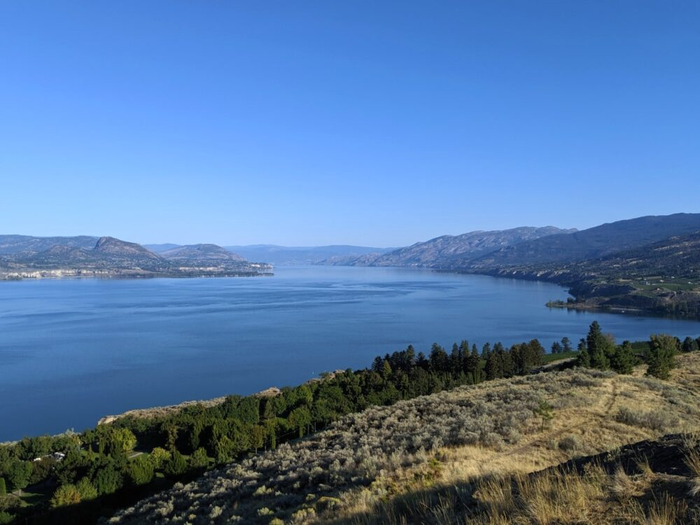 Munson Mountain summit view looking out over incredibly blue Okanagan Lake