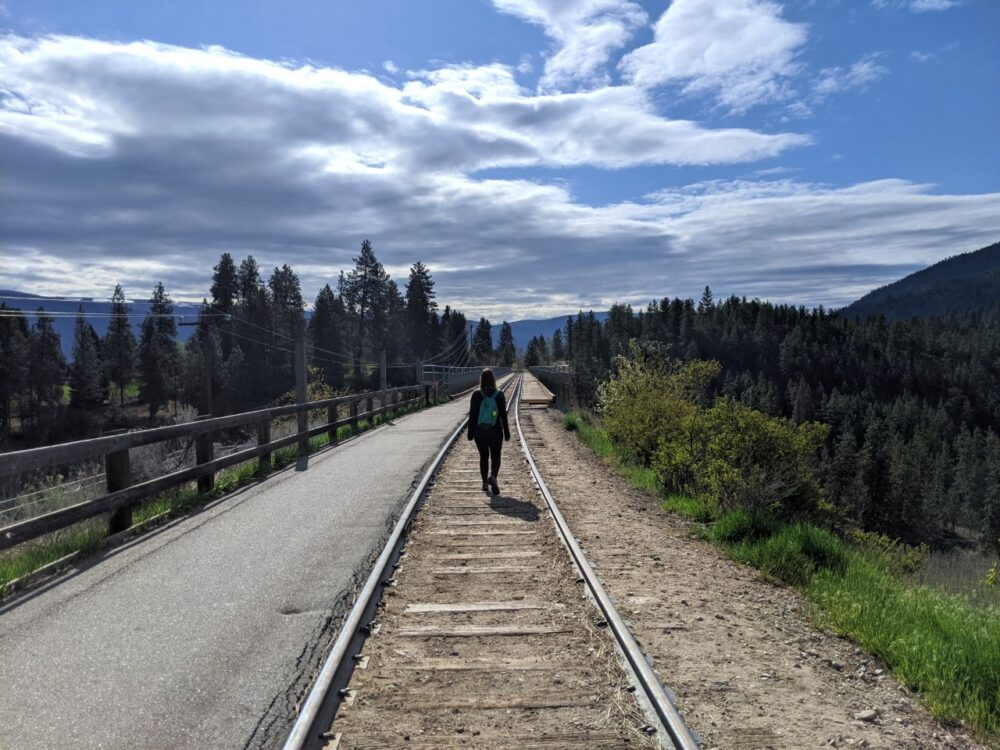 Gemma walking along the Kettle Valley Railway tracks (during non-operational hours), one of the many fun things to do in Summerland