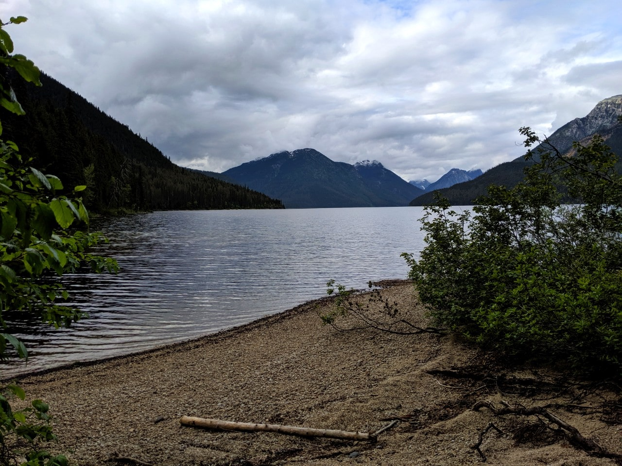 View from gravel beach at Little Anderson campsite looking up Murtle Lake towards mountainous North Arm of lake
