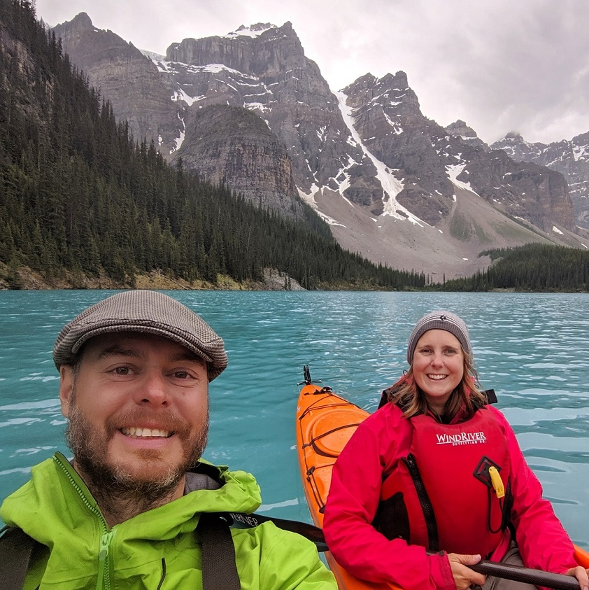 gemma and jr in kayaks on turquoise moraine lake with mountains behind
