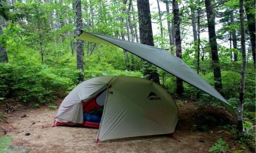 Set up tent with lightweight tent at diagonal angle above