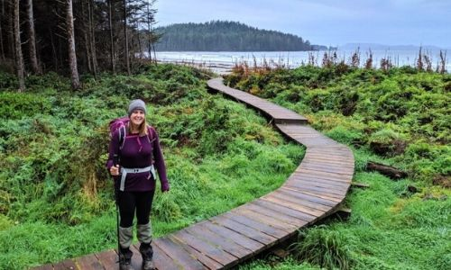 Gemma standing on boardwalk with ocean behind