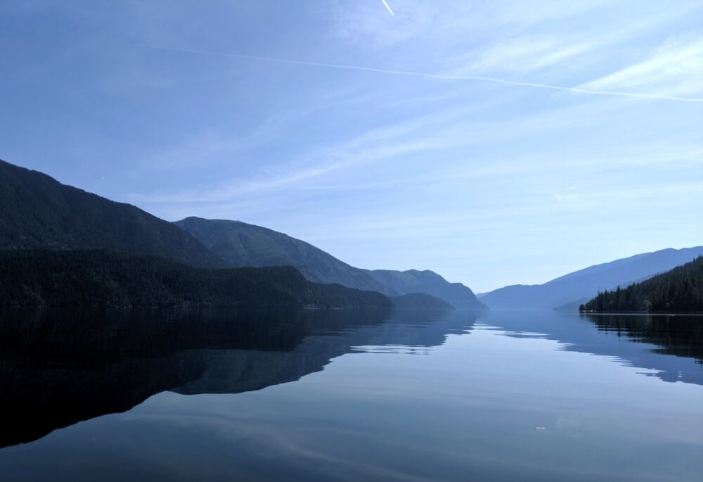 Mirror like reflections on the surface of Slocan Lake, Valhalla Provincial Park