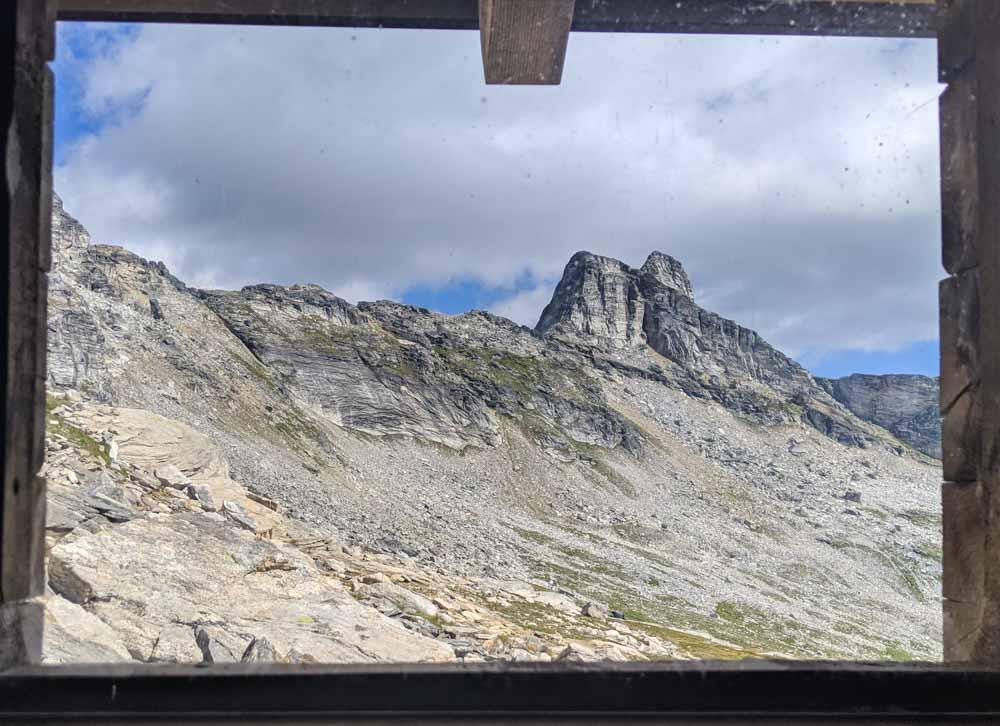 Window view from Gimli Ridge outhouse showing mountain range