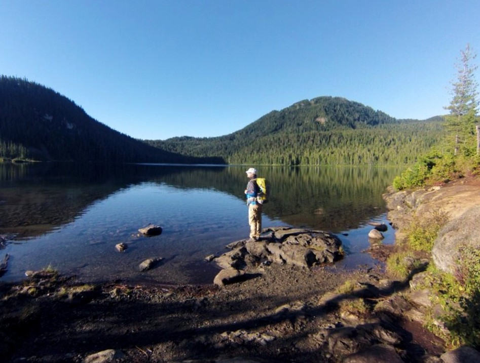 JR standing by Lake Helen Mackenzie in Strathcona Provincial Park