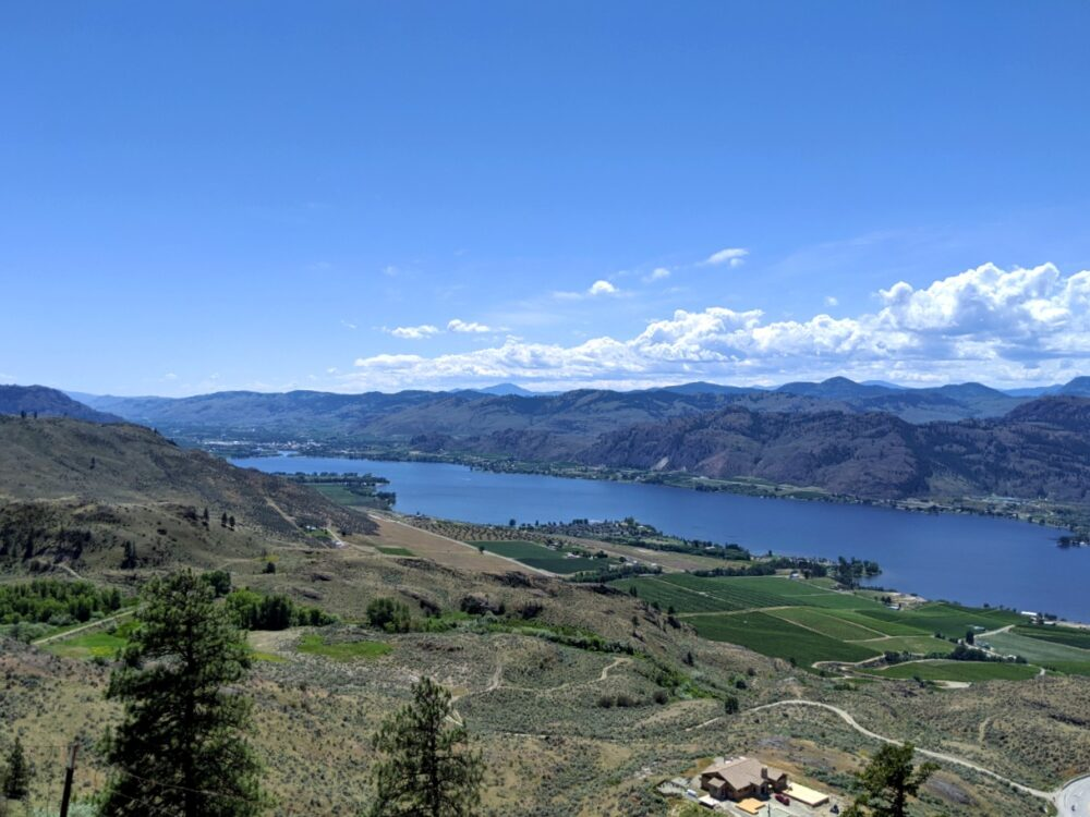 Elevated view looking down on Osoyoos Lake lined with brown hills