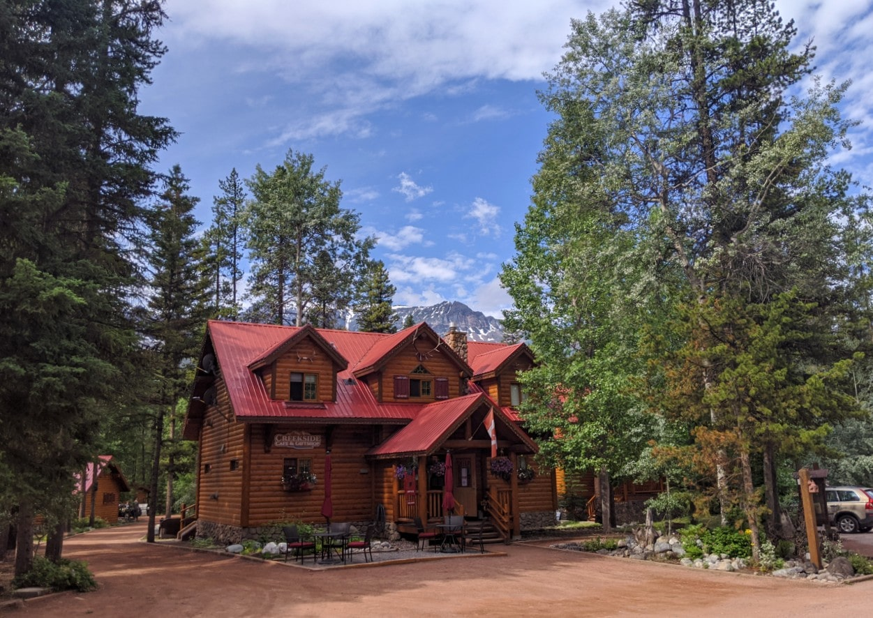 Two floor red roofed cabin style building at Baker Creek Mountain Resort, member of the Charming Inns of Alberta
