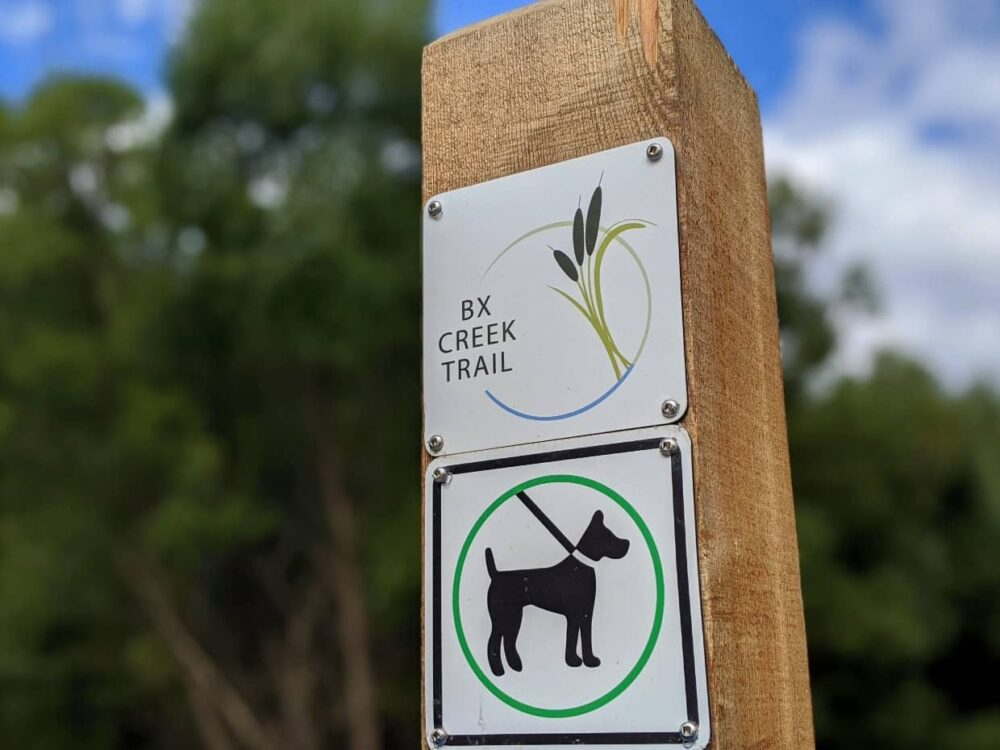 Close up of BX Creek Trail sign