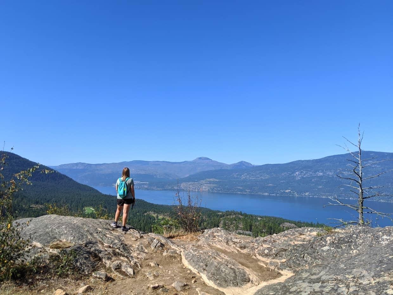 Gemma standing on top of rock at Okanagan Lake lookout, Predator Ridge