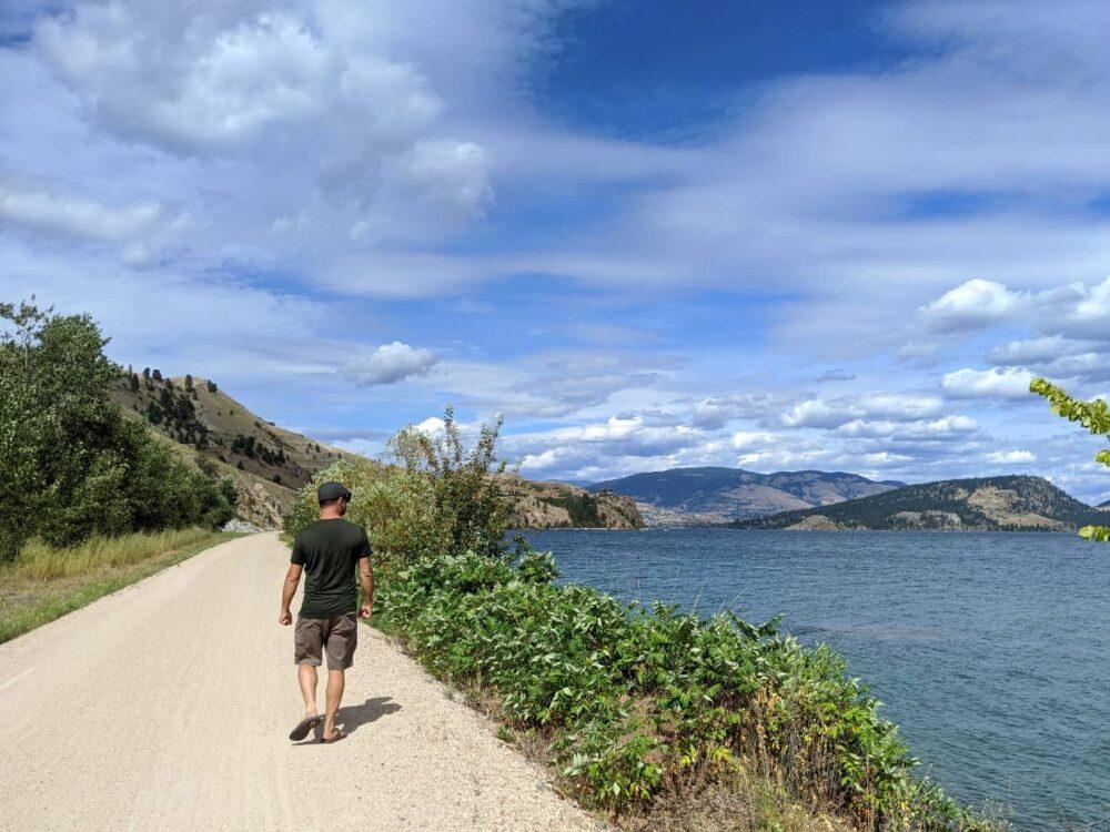 JR walking on Okanagan Rail Trail near Vernon, following Kalamalka Lake