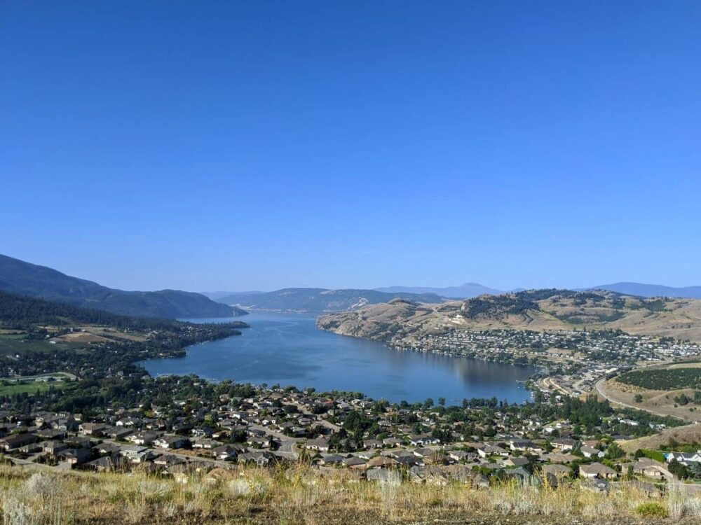 Elevated view from Middleton Mountain looking down at housing estate and Kalamalka Lake below