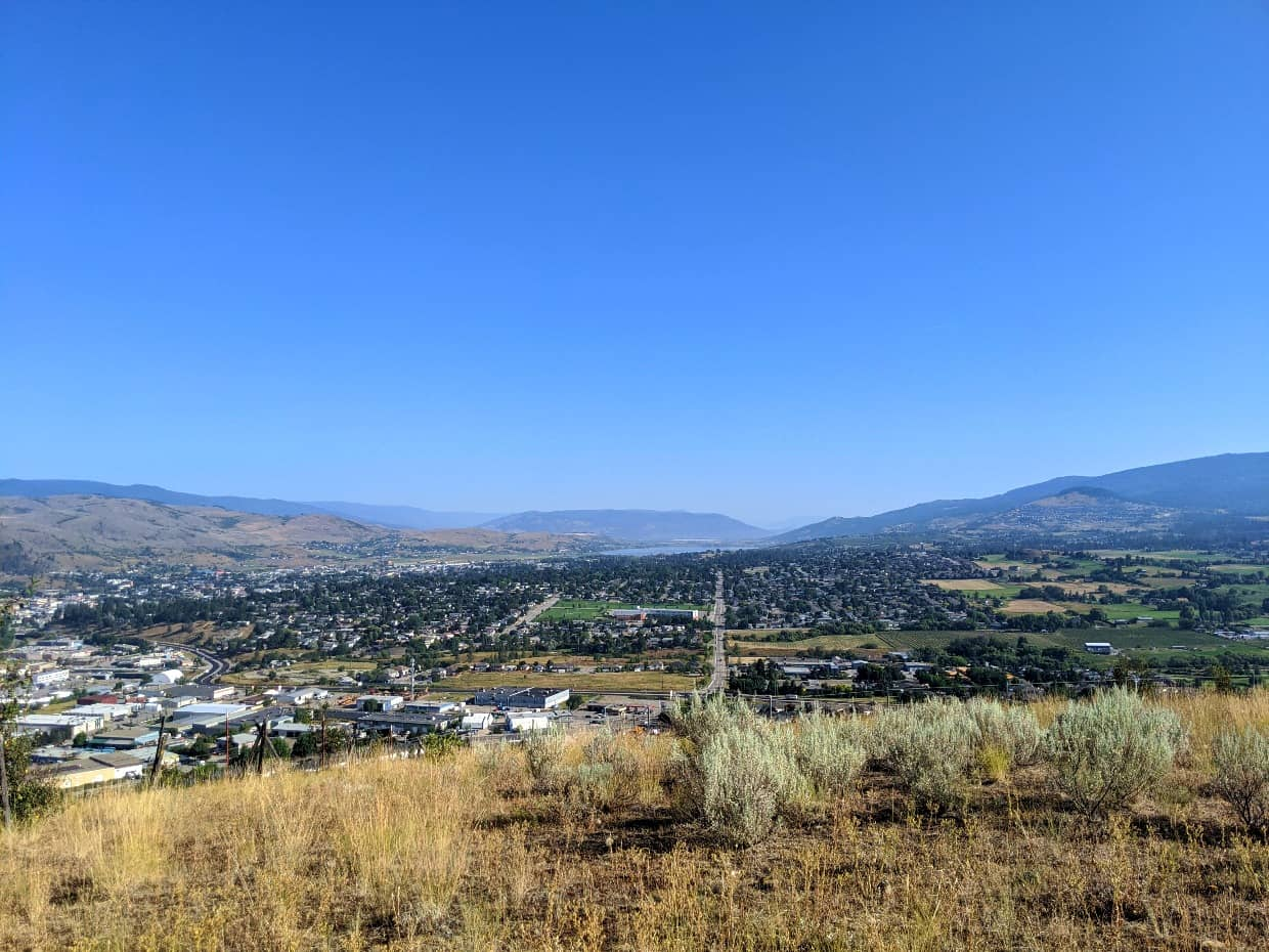 View of Vernon city and suburbs from Middleton Mountain, surrounded by rolling grasslands