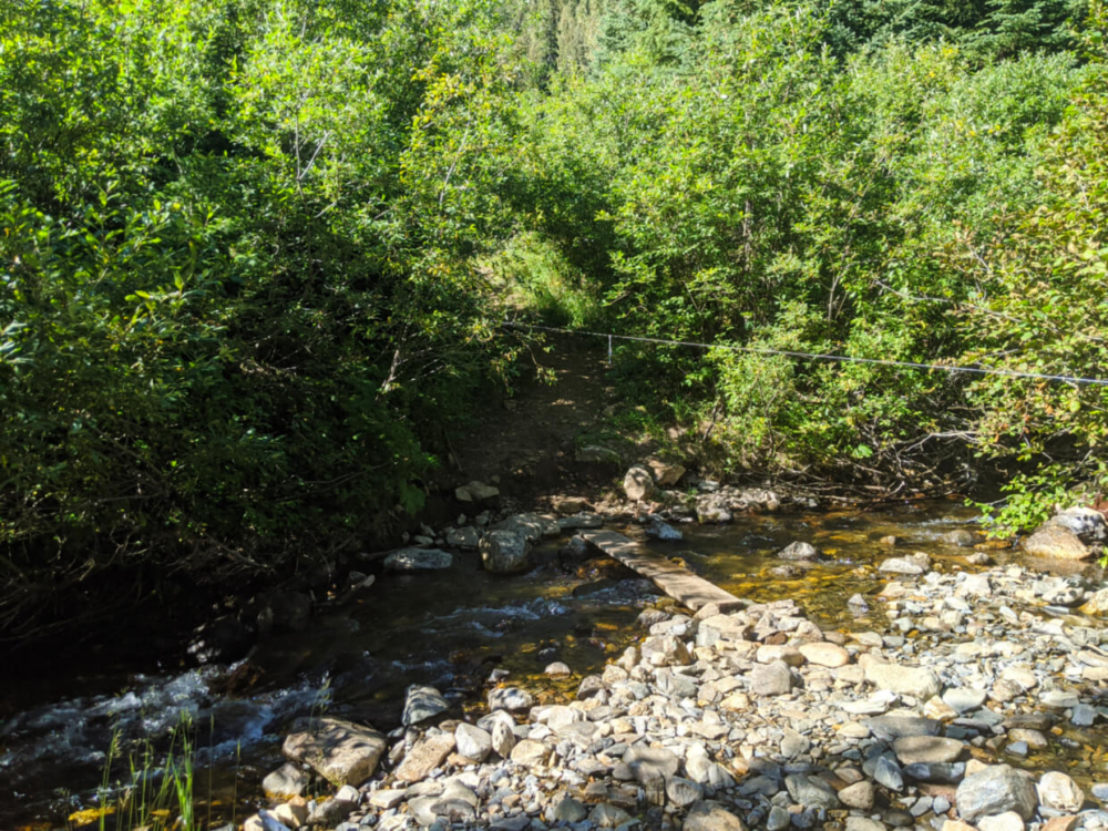 Rocky creek crossing with plan of water over water with rope guide