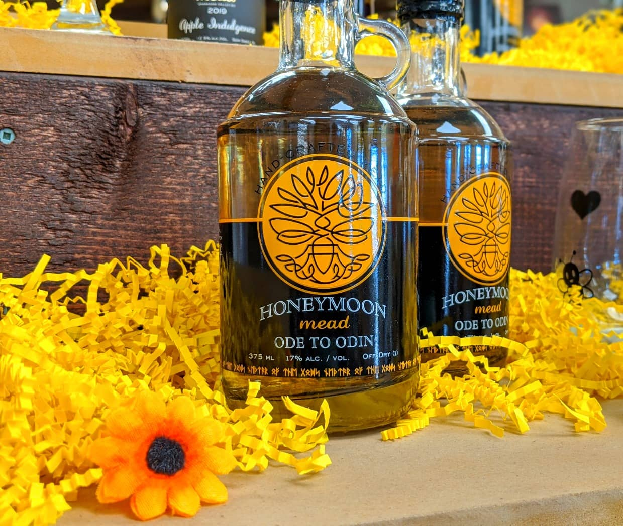 Two bottles of Ode to Odin Honeymoon Mead on tasting bar at Plant Bee Honey Farm in Vernon