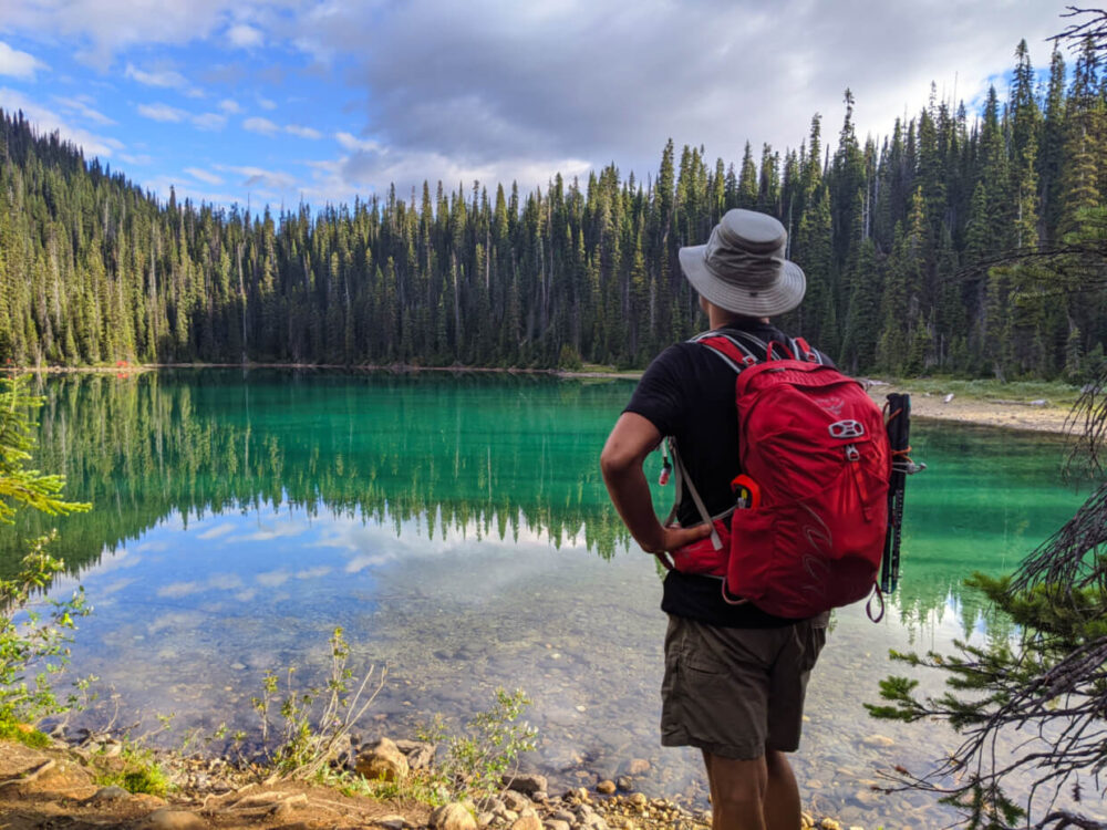 JR standing in front of turquoise Yoho Lake on the way to the Burgess Shale