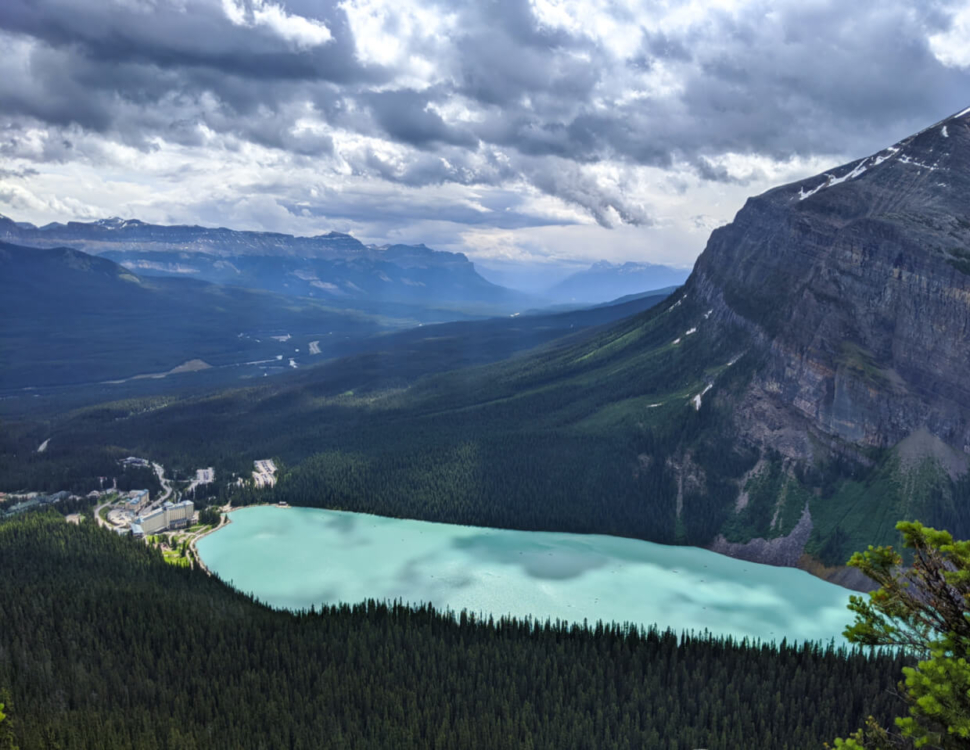 Looking down on the bright milky aquamarine colours of Lake Loise, with Fairmont Hotel on left