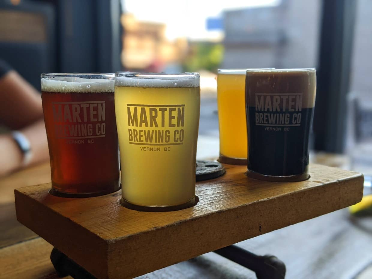 Tasting flight at Marten Brewing Co in Vernon, BC with four different varieties of beer