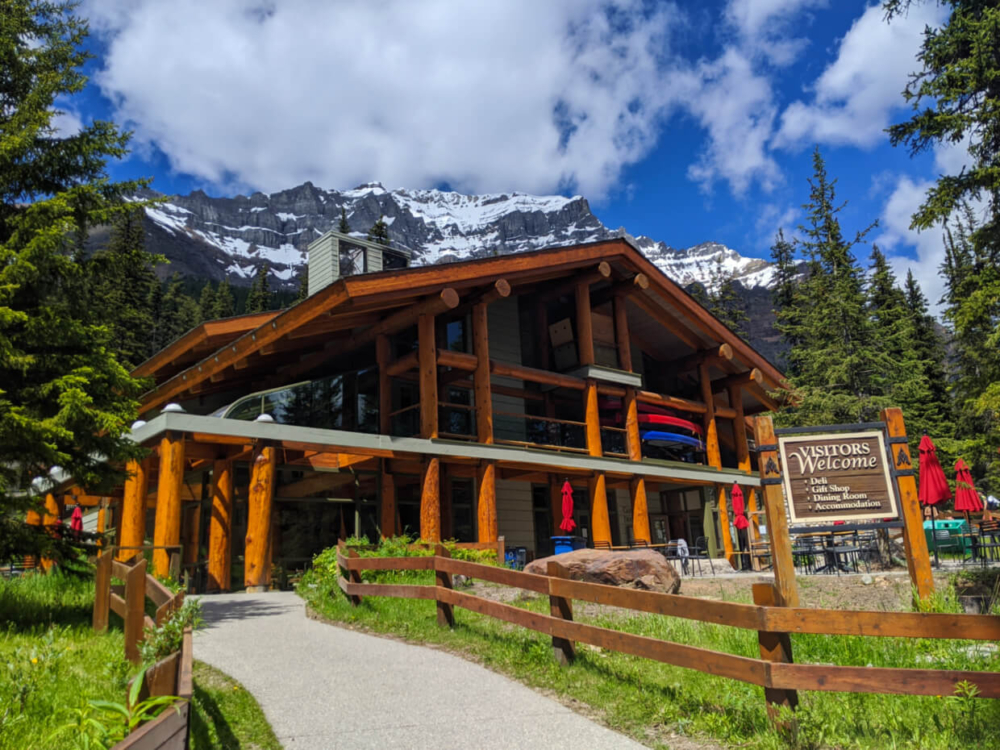 Moraine Lake Lodge log beam building with mountainous background