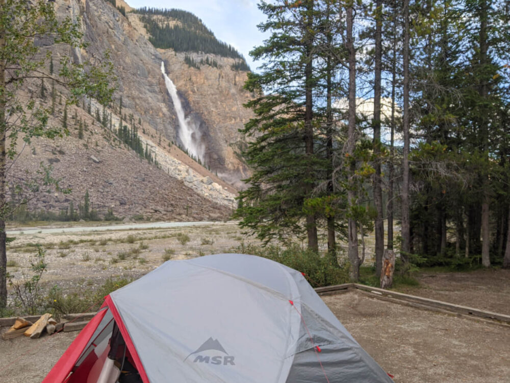 Looking over the top of MSR Elixir tent at huge cascading waterfall in Yoho National Park