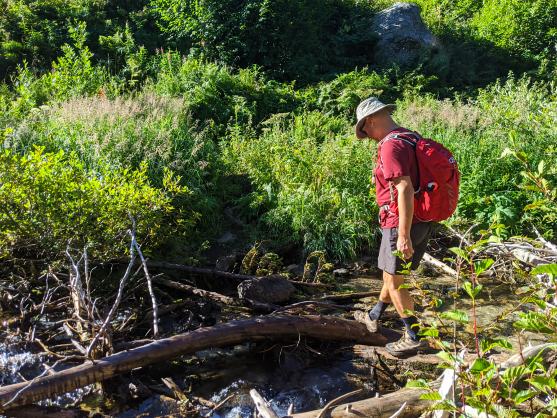 JR crossing Railroad Creek on logs and rocks