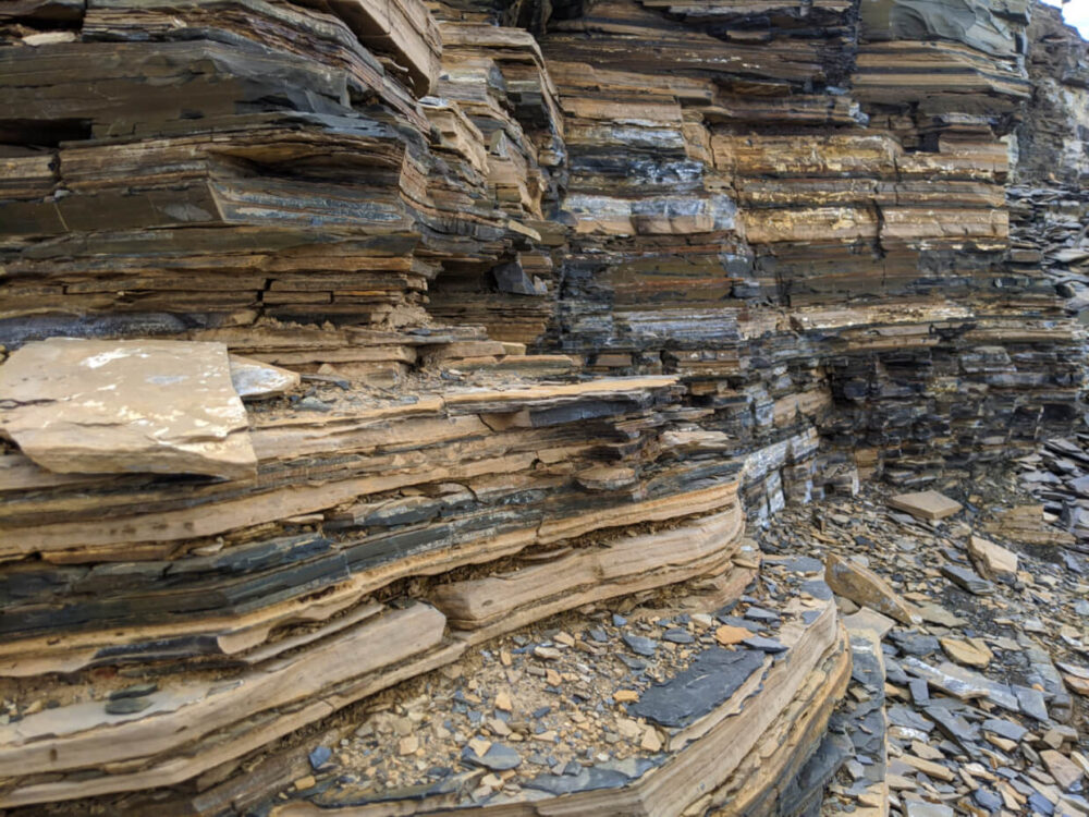 Side view of shale layers at Walcott Quarry, with broken shale pieces on ground