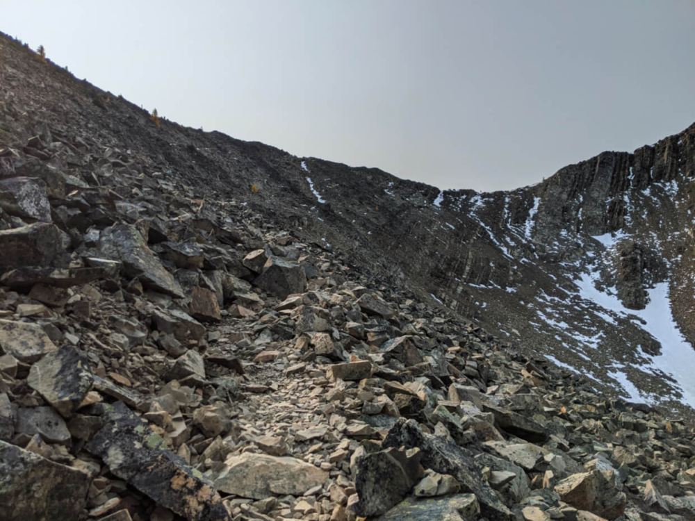 Scree slope leading to Frosty Mountain ridge, with large rocks