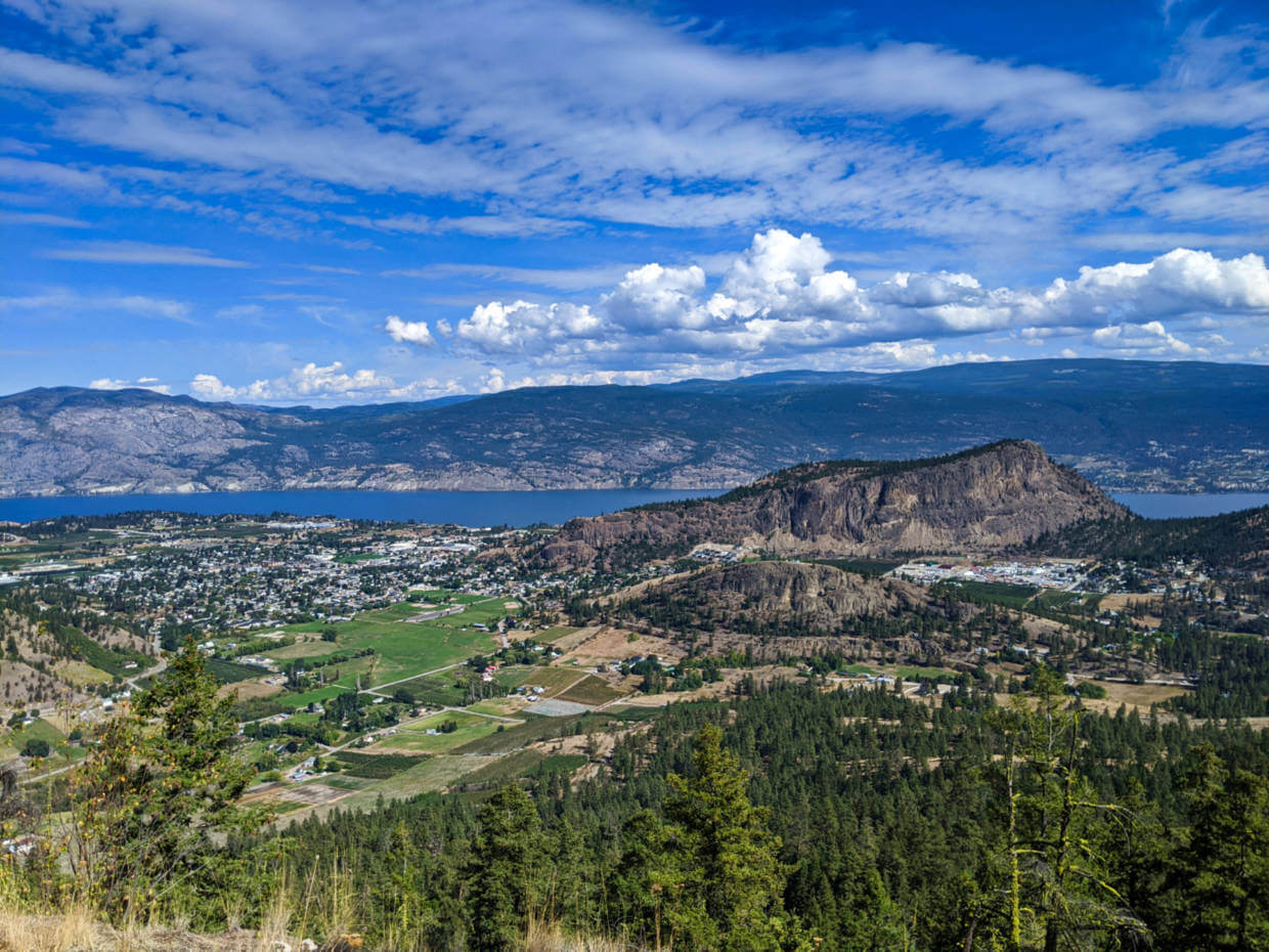 View from Mount Conkle of vineyards and orchards below in Summerland, rugged Giant's Head Mountain across and Okanagan Lake at the back