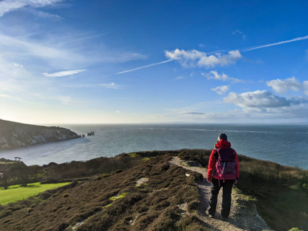 Gemma looking out to views of the Needles from Headon Warren on the Isle of Wight