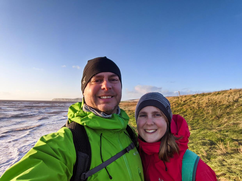 Gemma and JR selfie in font of coastal scenery in UK