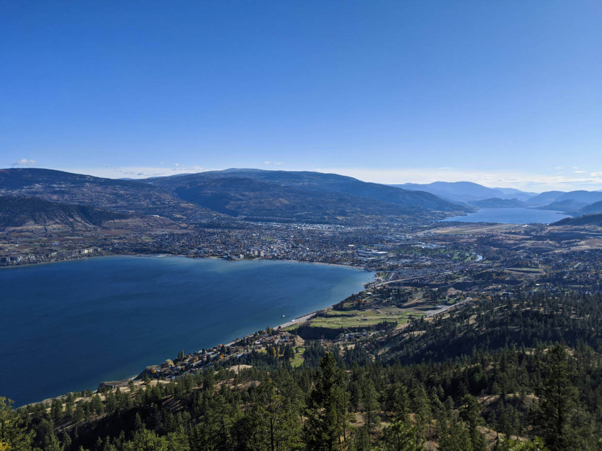 Looking down from mid way up Mount Nkwala to the city of Penticton with Okanagan Lake on one end and Skaha Lake on the other, surrounded by hills