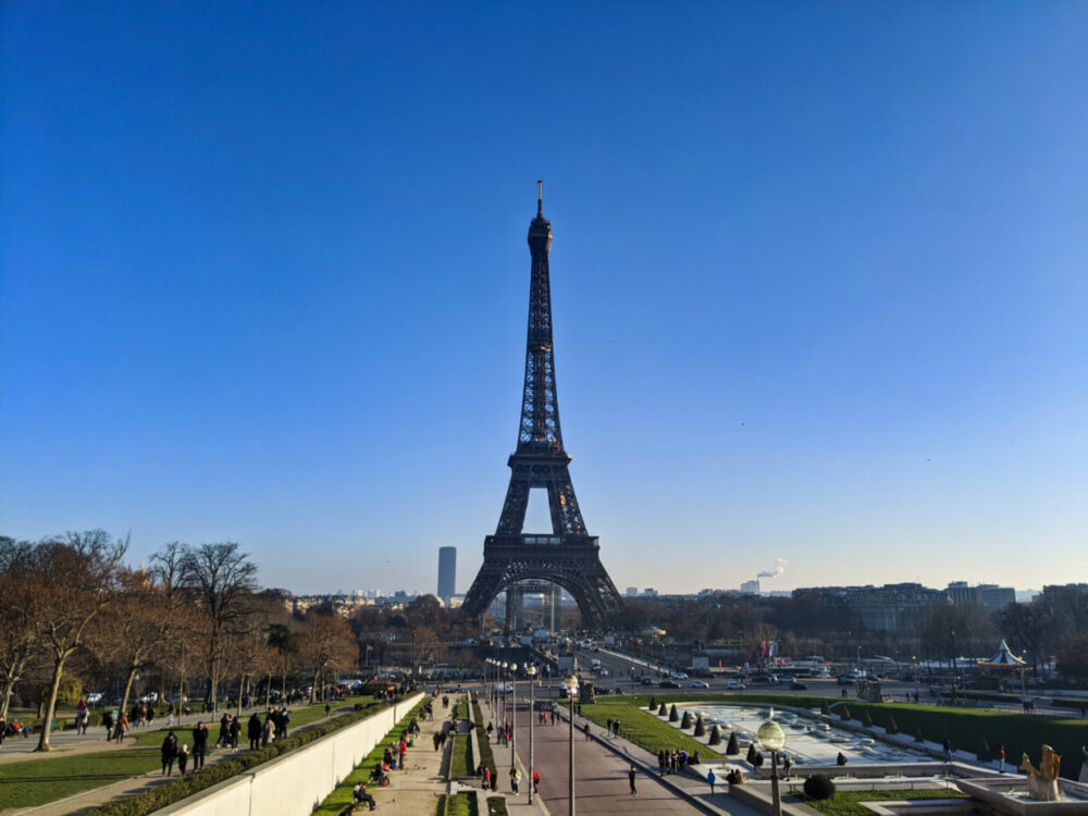 View looking towards Eiffel Tower in Paris on sunny day, with gardens in front
