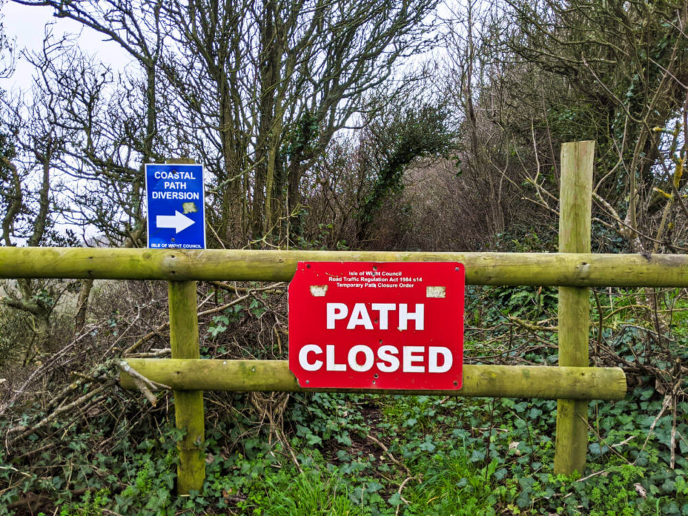 Isle of Wight Coastal Path diversion with path closed sign in front of overgrown section