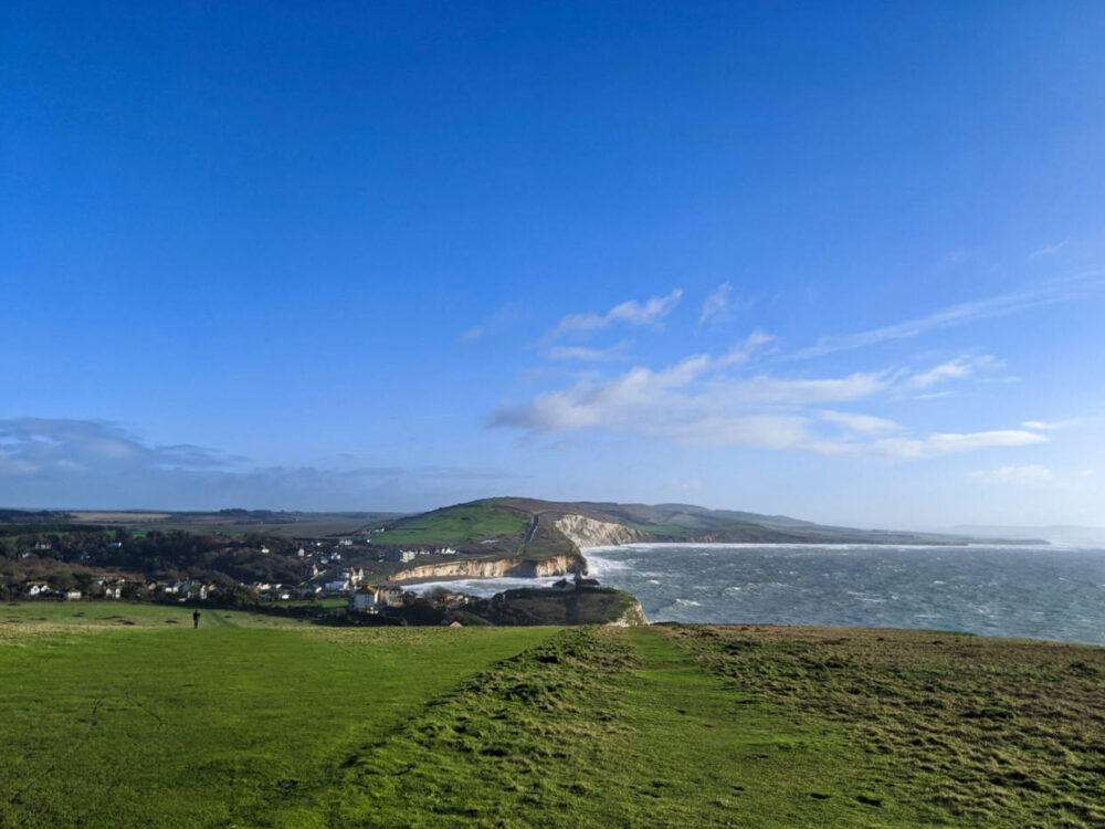 Looking back at Freshwater Bay and surrounding chalk cliffs grassy from Tennyson Down