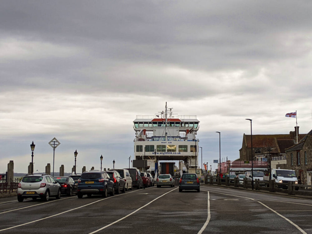 Parking area for loading onto Wight Link ferry, with boat in background
