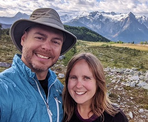 Selfie of JR (left) and Gemma (right) in front of mountainous scenery