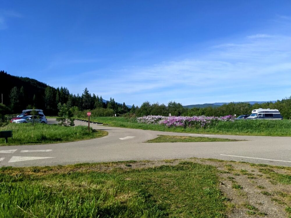 View of Enderby Cliffs parking lot, with cars visible on right and additional vehicles on the right