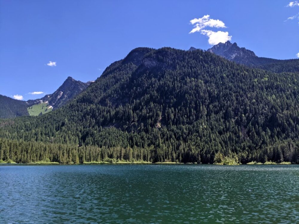 Looking across Spectrum Lake towards mountain peaks on the far shore