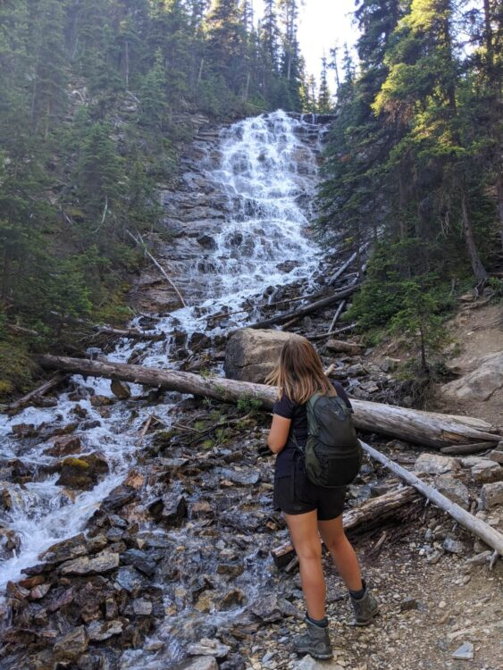 Back view of Gemma looking up at cascading waterfall on Iceline Trail, Yoho National Park