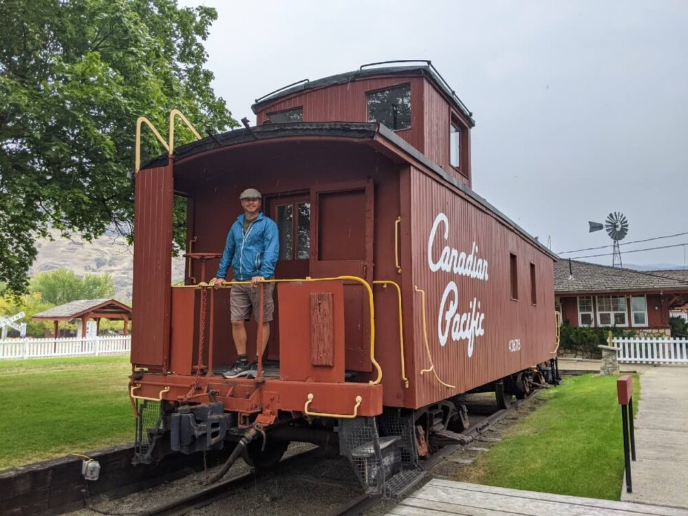 JR standards on the back of a red coloured caboose railway carriage at Kettle River Museum