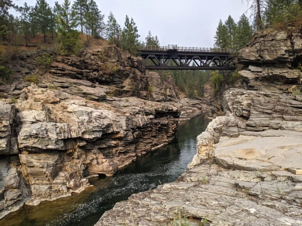Rocky Cascade Gorge with river running through canyon and trestle spanning the gap