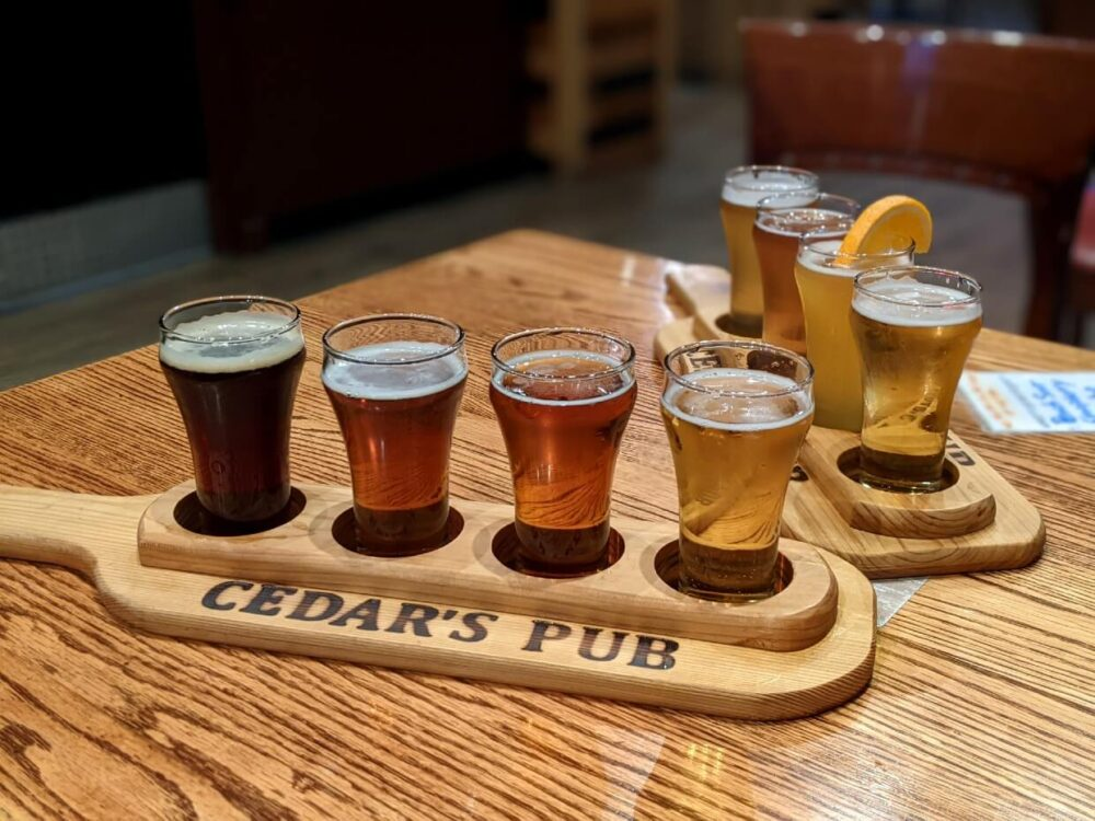 Close up of two beer flights (each with four differently coloured beers) at Cedar's Pub