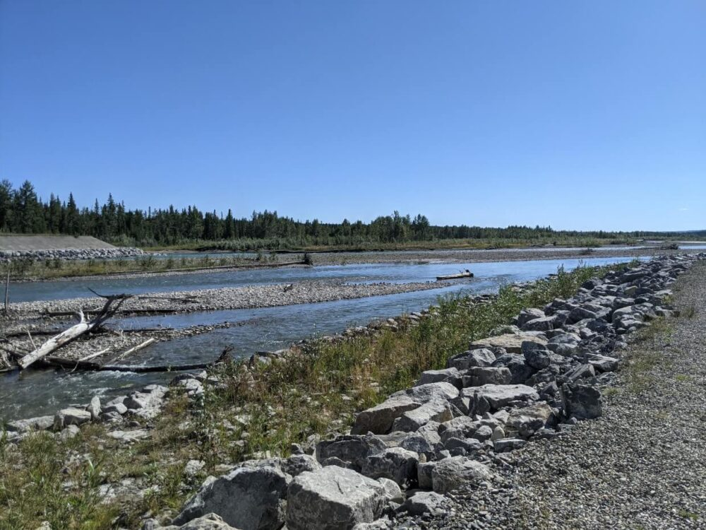 Trail view of the Red Deer River running through Sundre, bordered by forest